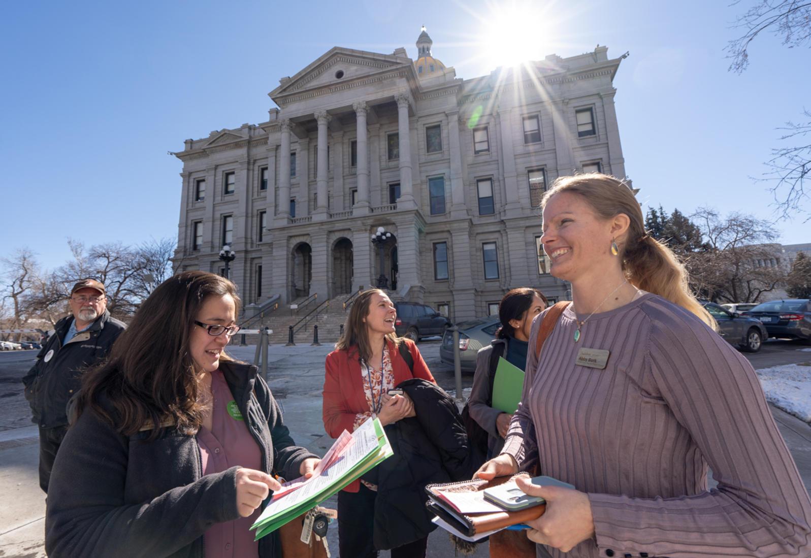 Audubon staff and members walk to meet with Coloradan legislators at Getting Green Laws 2019.