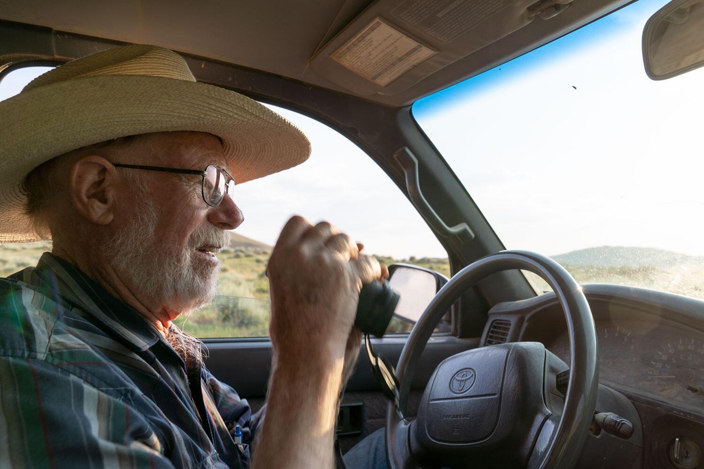 Stacey Scott inspects a bird from his truck.