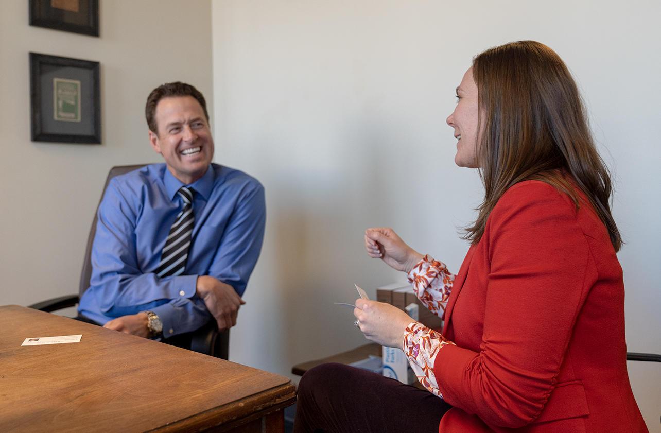 Kate Hogan of Denver Audubon speaks to Senator Jim Smallwood about funding for conservation.