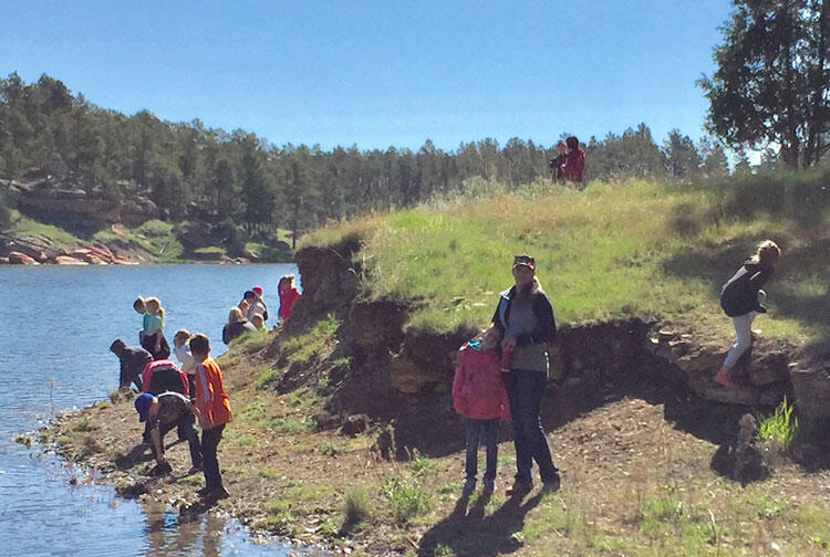 Students explore the edge of a river.