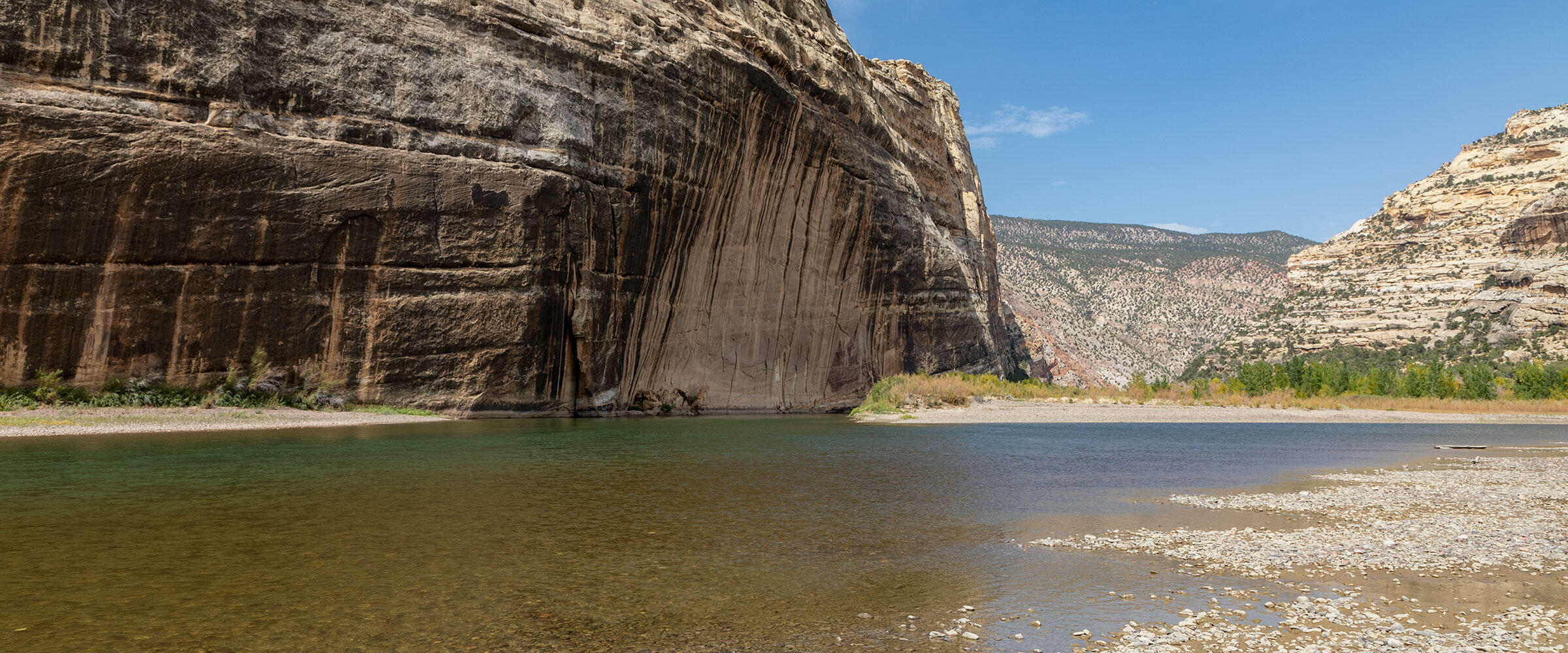 The Green River by a steep cliff.