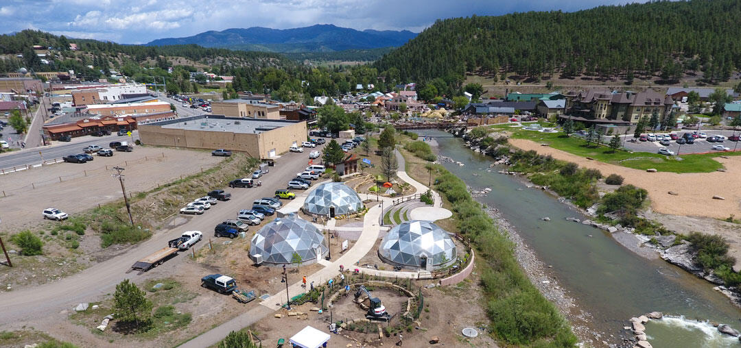 A new garden sits in front of geothermal domes by the river in Pagosa Springs.