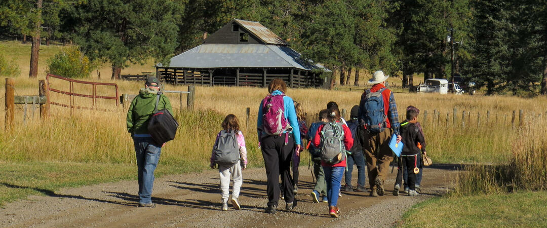 Students walk towards Four Mile Ranch.